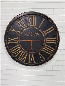 Sale 9151 - Lot 1374 - Timber wall mount clock marked Peace Hotel (dia:83cm)