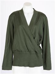 Sale 8640F - Lot 25 - An Escada dark green cross over jumper, with shoulder pads, size 42.