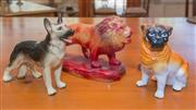 Sale 8368A - Lot 65 - A ceramic figure of a German shepherd dog, together with a pug dog, and a pottery lion, L of lion 27 cm