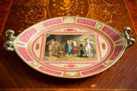 Sale 8392H - Lot 12 - A Vienna porcelain oval form two handled tray painted in the manor of Angelica Kauffmann, L 50cm, damage to handle
