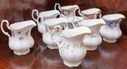 Sale 8649A - Lot 17 - A collection of nine various Royal Albert bone china milk jugs