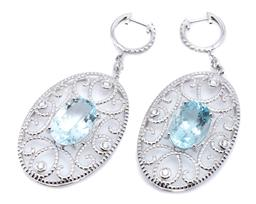 Sale 9253J - Lot 437 - A PAIR OF 18CT WHITE GOLD AQUAMARINE AND DIAMOND EARRINGS; oval drops each centring an oval cut aquamarine to scrolling open surroun...