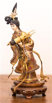 Sale 8284A - Lot 62 - An Oriental figure of a dancing lady in bejewelled and gilded robes, on timber base, height 25cm