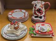 Sale 8310A - Lot 209 - A quantity of Christmas and gift crockery including dinner plates, Santa plates, salt and pepper shakers, platters and a Santa jug