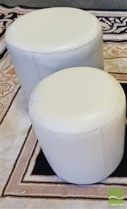 Sale 8440 - Lot 1018 - Two Beige Graduating Round Ottomans