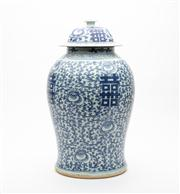 Sale 8844 - Lot 32 - A Chinese blue and white lidded baluster vase with double happiness symbols amidst floral motif. Height 44cm.