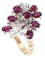 Sale 8915 - Lot 399 - A TWO TONE 14CT GOLD GEMSTONE COCKTAIL RING; set in white gold with round and oval cut rubies and single cut diamonds on a beaded sh...