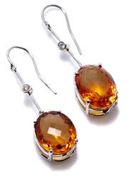 Sale 8974 - Lot 394 - A PAIR OF CITRINE AND DIAMOND EARRINGS; each an approx. 7.7ct oval cut citrine suspended from a line drop set with a round brilliant...