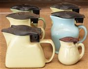 Sale 8984H - Lot 382 - Six small early ceramic electric kettles.