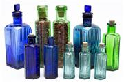 Sale 9054E - Lot 84 - A small quantity of unlabelled bottles in blue and green, some impressed not to be taken,