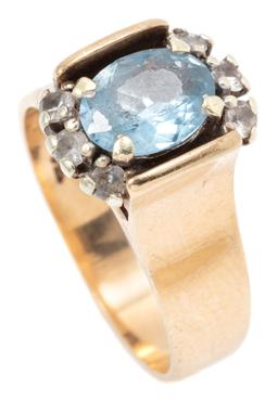 Sale 9145 - Lot 346 - A VINTAGE 9CT GOLD GEMSET RING; 7mm wide tapering band set with a blue and white faceted pastes, size N, 6.09g.
