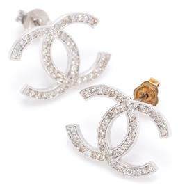 Sale 9140 - Lot 387 - A PAIR OF 18CT WHITE GOLD AND DIAMOND STUD EARRINGS; in the Chanel style each set with 46 mixed round brilliant and single cut diamo...