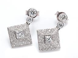 Sale 9260H - Lot 352 - A pair of 18ct white gold diamond earrings; each centring a princess cut diamond of approx. 0.40ct to surround of 48 round brilliant...