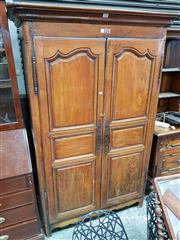 Sale 8714 - Lot 1072 - 19th Century French Cherrywood Armoire, with two shaped panel doors