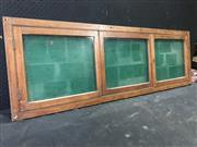 Sale 9022 - Lot 1007 - A three bay glazed maple commercial notice board, 51 x 155cm