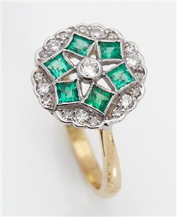 Sale 9123J - Lot 141 - An 18ct yellow and white gold ring, the centre diamond framed by 6 square cut emeralds within a scalloped border of 18 diamonds