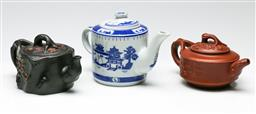 Sale 9209 - Lot 73 - Three Chinese teapots incl. Yixing examples (H:13.5cm)