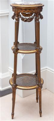 Sale 8595A - Lot 53 - A Louis XV style gilt étagère with round marble to, Vitruvian scrolls and festoons, raised on turned footed legs joined by caned tie...
