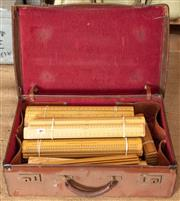 Sale 8984H - Lot 384 - An early leather childs brief case containing a substantial quantity of early unused British made timber rulers.