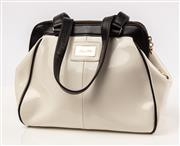 Sale 9027F - Lot 2 - An Alannah Hill trapeze bag in white and black with bow detail to back and gold hardware