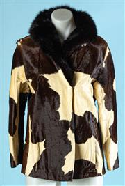 Sale 9090F - Lot 89 - A CORNELIOUS ORIGINAL COW HIDE JACKET; featuring slit pockets to the front sides and a black fur collar, having slight tear to RHS s...