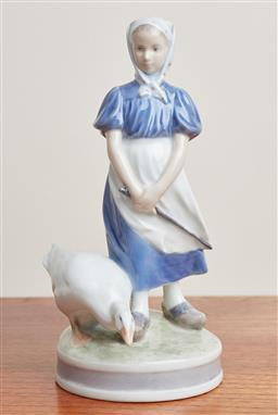 Sale 9099 - Lot 104 - A Royal Copenhagen figure of a Goose and girl. Height 23cm