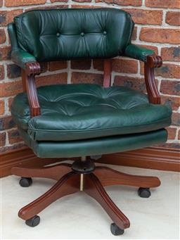 Sale 9155H - Lot 73 - A carved timber green leather upholstered swivel barristers chair. height of back 82cm, Purchased at Buckleys May 2000