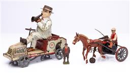 Sale 9185E - Lot 140 - A group of three tin plate and lead toys, tallest Height 16cm