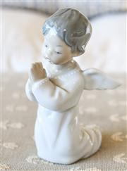 Sale 8250 - Lot 32 - A Lladro Figure, modelled as a  small child in the form of an angel praying