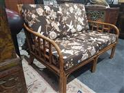 Sale 8760 - Lot 1026 - Cane Two Seater with Cushions
