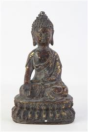 Sale 8863H - Lot 33 - A bronze Buddha with mottled gold patina, Height 20cm