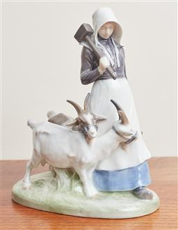 Sale 9099 - Lot 105 - A Royal Copenhagen figure of a young woman with goats. Height 24cm