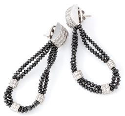 Sale 9140 - Lot 395 - A PAIR OF BLACK AND WHITE DIAMOND DROP EARRINGS; each 2 rows of 2.5mm round faceted black diamond beads united by 3 pave set round b...