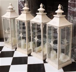 Sale 9190H - Lot 249 - A set of four white painted metal lanterns with candles, Height 74cm