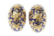 Sale 8574 - Lot 334 - A PAIR OF 18CT GOLD AND ENAMEL CLIP EARRINGS; dome shape featuring leaf motifs in a ground of blue enamel, wt. 12.5g.