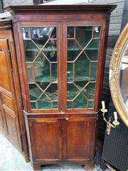 Sale 8714 - Lot 1073 - Georgian Oak Corner Cabinet, in two sections, with two astragal doors, mahogany band & two panel doors below