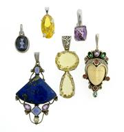 Sale 8134B - Lot 312 - A GROUP OF STERLING SILVER PENDANTS; set with citrine, lapis, amethyst, green sapphire, garnet, and a bone mask. Wt. 75.8g.