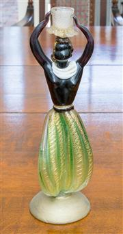 Sale 8402H - Lot 56 - A Murano glass figurine wearing aventurine loon pants, and carrying a candle holder aloft. Height 35cm.