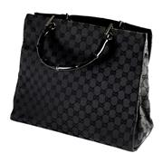 Sale 8060B - Lot 398 - A GUCCI MONOGRAM BLACK BAG; with black bamboo handles and interior tag no. 002.1010-002122, width 34cm
