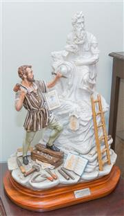 Sale 8368A - Lot 71 - A Capodimonte ceramic sculpture titled Mose di Michelangelo (Michelangelo sculpting Moses) numbered 43 of 1500, on fitted wooden s...