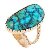 Sale 8879 - Lot 333 - A 14CT GOLD TURQUOISE RING; cut down claw set with a 24 x 12.8mm freeform turquoise (crack) to split textured shoulders, size O, wt....
