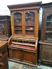 Sale 8956 - Lot 1068 - Victorian Mahogany Cylinder Bureau Bookcase, with two arched glass panel doors, a fitted interior with slide-out drawer & two panel...