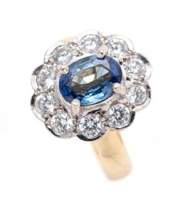 Sale 9260H - Lot 362 - An 18ct gold sapphire and zirconia cluster ring; centring an oval cut sapphire of approx. 1.60ct (chipped) to surround of 10 round c...