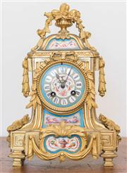 Sale 8284A - Lot 26 - A French 19th Century porcelain and ormolu mantel clock, decorated with cherubs and vases of pomegranates, by Henry Marc, height 31cm