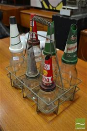 Sale 8511 - Lot 1058 - Set of Six Various Embossed Castrol Vintage Glass Oil Bottles in Carrier