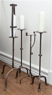 Sale 8838H - Lot 21 - Four iron floor standing candle holders. Height of tallest 140cm
