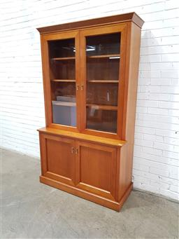 Sale 9134 - Lot 1551 - Timber display cabinet with two glass panel doors above two timber doors (h:211 w:124 d:52cm)