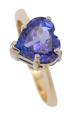 Sale 9186 - Lot 353 - A 18CT GOLD TANZANITE HEART RING; featuring a heart cut  tanzanite of approx. 1.69ct on reverse tapered shank, width 9mm, size I, wt...