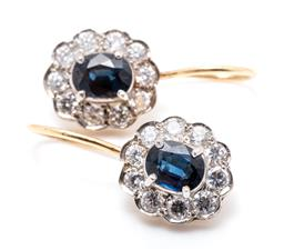 Sale 9260H - Lot 365 - A pair of 16ct gold sapphire and zirconia cluster earrings; each centring an oval cut sapphire to surround set with 10 round cut zir...