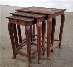 Sale 9255 - Lot 1256 - Nest of three carved top timber tables, the smallest with a drawer (h:40 w:38 d:27cm)